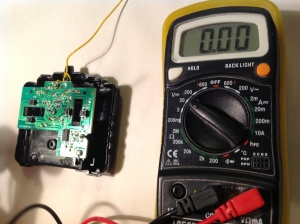 Multimeter set to 20 volts ready to test