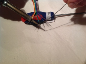 Tinning the green wire with solder further on