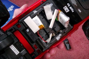 Inserting batteries into rc car